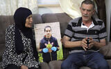 The parents of Iyad Halak, an autistic Palestinian man who was fatally shot by Israeli police, Khiri, right, and mother Rana, talk during an interview in Jerusalem, June 3, 2020. (Mahmoud Illean/AP)