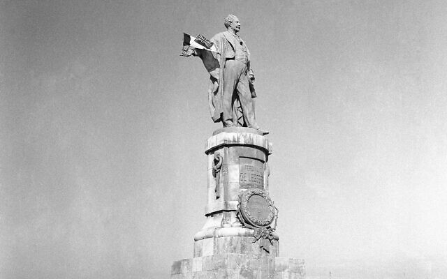 The statue of Ferdinand de Lesseps, the French diplomat who was behind the construction of Egypt's Suez Canal, is seen in the harbor of Port Said, Egypt, on December 22, 1956. (AP Photo/Jim Pringle, File)