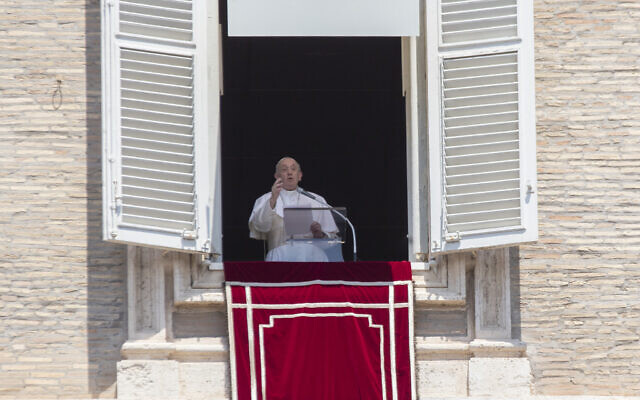"Pope Francis delivers his message after the Angelus noon blessing from the window of his studio overlooking St. Peter's Square at the Vatican, Sunday, July 12, 2020. In a very brief, improvised remark, Pope Francis, speaking from his studio window overlooking St. Peter's Square, said he is ""deeply pained"" over the decision by Turkey to change the status of Hagia Sophia, which had originally been built as a Christian cathedral, from that of a museum in Istanbul to a mosque.  (AP Photo/Alessandra Tarantino)"