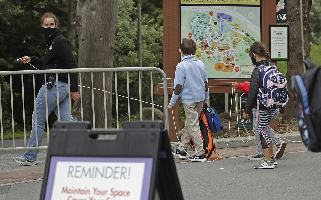US debates school reopening as WHO warns 'no return to normal' anytime soon