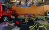 In this July 1, 2020, file photo, Abel Gomez waits for his order at Mariscos Linda food truck as dining tables are sealed off with caution tape due to the coronavirus pandemic in Los Angeles. (AP Photo/Jae C. Hong, File)