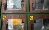 A ready to take away Go Noodles box is placed in a glass-paned locker in Tel Aviv, on July 16, 2020. (Ariel Schalit/AP)