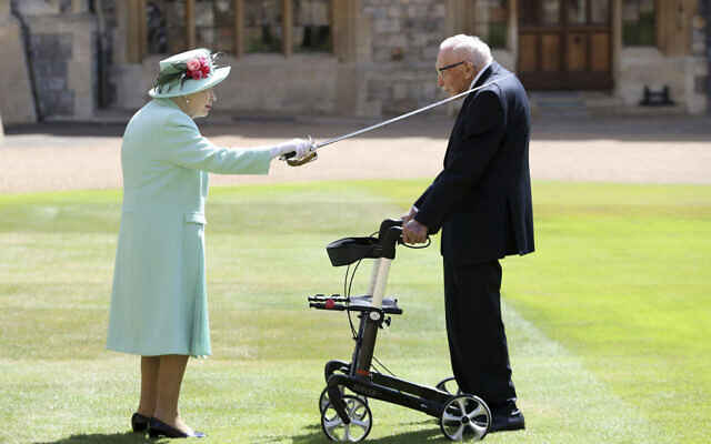 Captain Sir Thomas Moore receives his knighthood from Britain's Queen Elizabeth, during a ceremony at Windsor Castle in Windsor, England, Friday, July 17, 2020 (Chris Jackson/Pool Photo via AP)