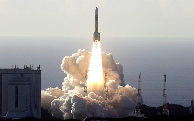 An H-IIA rocket with United Arab Emirates' Mars orbiter Hope lifts off from Tanegashima Space Center in Kagoshima, southern Japan Monday, July 20, 2020. (Hiroki Yamauchi/Kyodo News via AP)