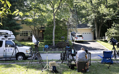 News media is set up in front of the home of US District Judge Esther Salas, July 20, 2020, in North Brunswick, New Jersey. (AP Photo/Mark Lennihan)