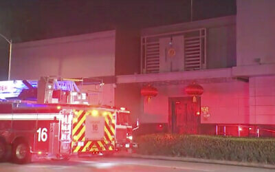 In this image made from video, a fire truck is seen outside the Chinese consulate in Houston, July 21, 2020. (KTRK via AP)