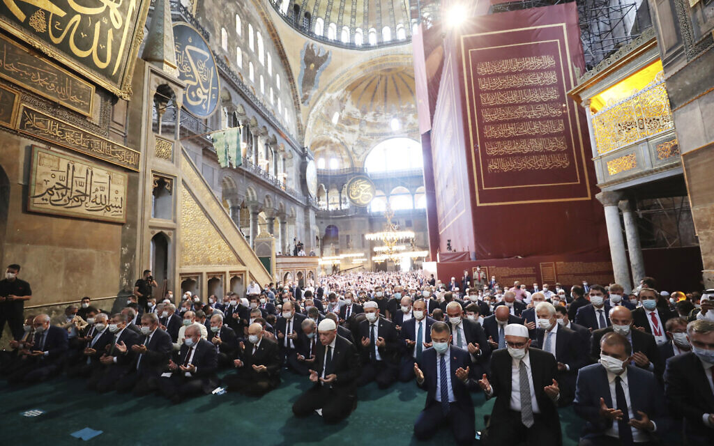 Turkey's President Recep Tayyip Erdogan, center, takes part in Friday prayers in Hagia Sophia, at the historic Sultanahmet district of Istanbul, July 24, 2020. (Turkish Presidency via AP, Pool)