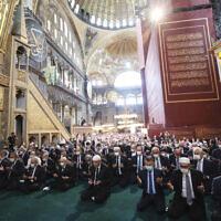 Turkey's President Recep Tayyip Erdogan, center, takes part in Friday prayers in Hagia Sophia, at the historic Sultanahmet district of Istanbul, July 24, 2020. (Turkish Presidency via AP, Pool)