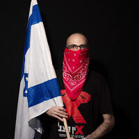 Dekel Gilag, 25, poses for a photo during a protest against Prime Minister Benjamin Netanyahu, outside his residence in Jerusalem, July 23, 2020. (AP Photo/Oded Balilty)