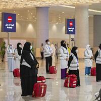 Pilgrims at King Abdulaziz Airport for the Hajj pilgrimage to Mecca, in Jeddah, Saudi Arabia, July 25, 2020. (Saudi Ministry of Media via AP)