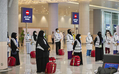 Pilgrims at King Abdulaziz Airport for the Hajj pilgrimage to Mecca, in Jeddah, Saudi Arabia, July 25, 2020. (Saudi Ministry of Media via AP)