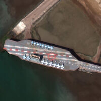 In this February 15, 2020, satellite photo provided on July 27, 2020, by Maxar Technologies, a mockup aircraft carrier built by Iran is seen at Bandar Abbas, Iran, before being put to sea. (Maxar Technologies via AP)