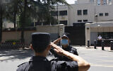 Chinese SWAT officers salute each other at the former United States Consulate in Chengdu in southwest China's Sichuan province on July 27, 2020 (AP Photo/Ng Han Guan)