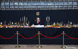 An installation depicting Prime Minister Benjamin Netanyahu at a mock 'Last Supper' by Israeli artist Itay Zalait, is placed at Rabin Square in Tel Aviv, July 29, 2020. (Oded Balilty/AP)