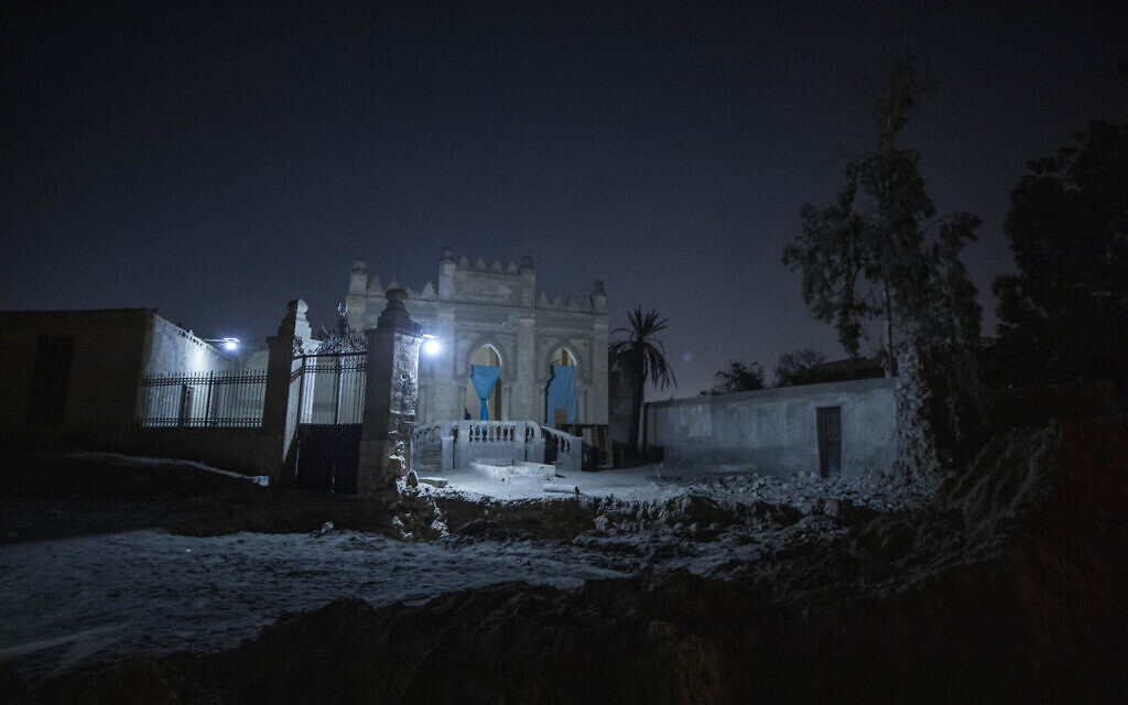 A tomb from the early 20th Century stands partially demolished amid construction of a new highway through the Northern Cemetery in Cairo, Egypt, Sunday, July 26, 2020. (AP Photo/Nariman El-Mofty)