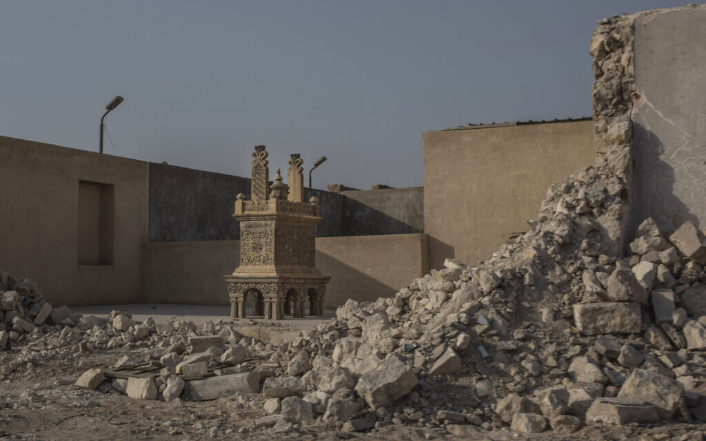 A tomb stands exposed after its walls were knocked down as part of construction of a new highway through the Northern Cemetery, part of the City of the Dead, a UNESCO World Heritage site, in Cairo, Egypt, Tuesday, July 28, 2020. (AP Photo/Nariman El-Mofty)