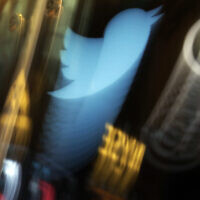 The Twitter logo appears on an updated phone post on the floor of the New York Stock Exchange, November 6, 2013. (AP Photo/Richard Drew, File)
