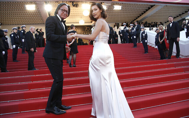 Mohamed Hadid, left, and Bella Hadid pose for photographers upon arrival at the opening ceremony and the screening of the film Ismael's Ghosts at the 70th international film festival, Cannes, southern France, May 17, 2017. (AP Photo/Thibault Camus)