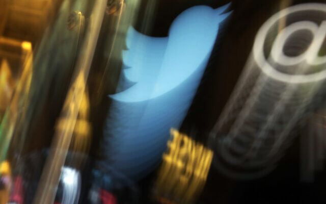 In this Wednesday Nov. 6, 2013, file photo, the Twitter logo appears on an updated phone post on the floor of the New York Stock Exchange. (AP/Richard Drew)