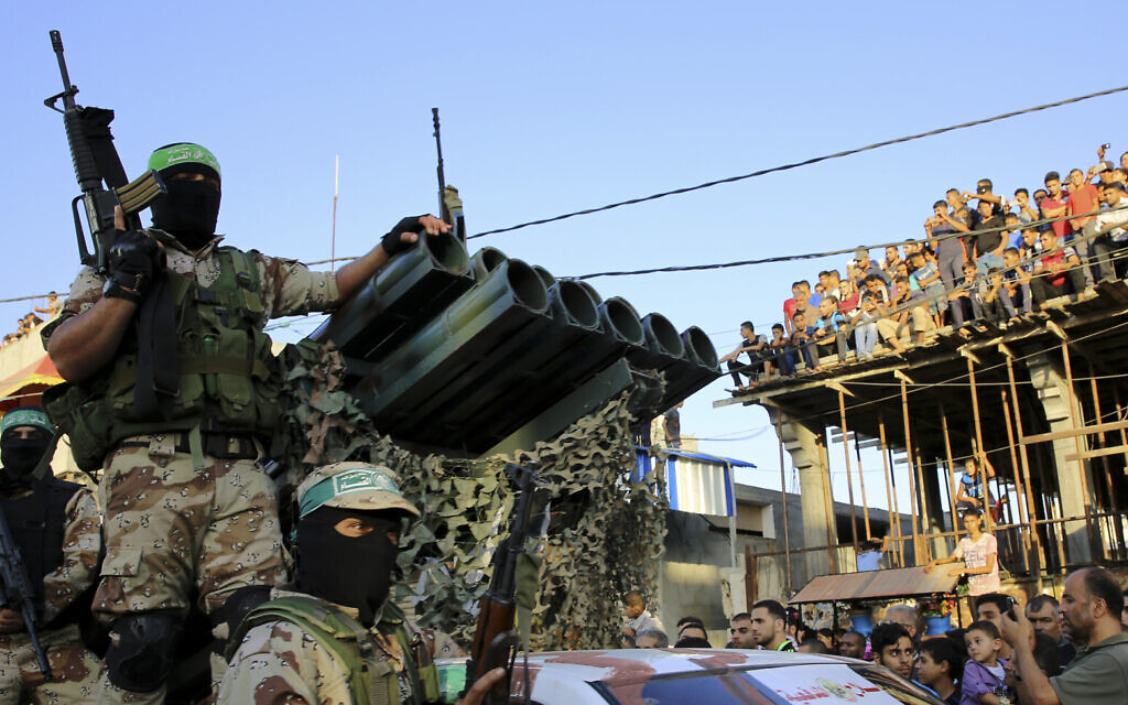 Masked members of Hamas ride a vehicle next to a rocket launcher during a rally in the Rafah refugee camp, Gaza Strip, Aug. 21, 2016 (AP Photo/Adel Hana)