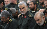 FILE - In this Sept. 18, 2016 file photo released by an official website of the office of the Iranian supreme leader, Revolutionary Guard Gen. Qassem Soleimani, center, attends a meeting with Supreme Leader Ayatollah Ali Khamenei and Revolutionary Guard commanders in Tehran, Iran. (Office of the Iranian Supreme Leader via AP)