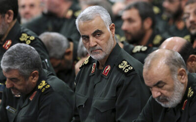 In this Sept. 18, 2016 file photo released by an official website of the office of the Iranian supreme leader, Revolutionary Guard Gen. Qassem Soleimani, center, attends a meeting with Supreme Leader Ayatollah Ali Khamenei and Revolutionary Guard commanders in Tehran, Iran. (Office of the Iranian Supreme Leader via AP)