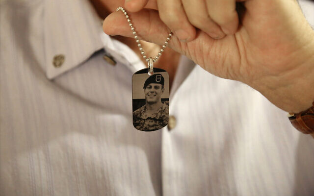 Brian McEnroe, the father of fallen US Green Beret Kevin McEnroe, displays a memorial dog tag depicting his fallen son, in Amman, Jordan, June 17, 2017. (Sam McNeil/AP)