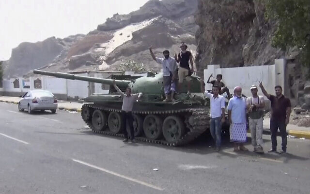 This frame grab from video shows fighters loyal to the separatist so-called Southern Transitional Council, backed by the United Arab Emirates, near the presidential palace, in Aden, Yemen on January 30, 2018. (AP Photo)
