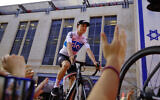 British cyclist Chris Froome rides during Team Sky presentation in Jerusalem, May 3, 2018 (AP Photo/Ariel Schalit)