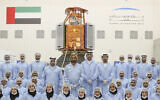In this undated photograph released Feb. 2, 2018 by the state-run Emirates News Agency (WAM), Sheikh Mohammed bin Rashid Al Maktoum, Dubai's ruler and the vice president and prime minister of the United Arab Emirates, center back row, visits the Mohammed bin Rashid Space Center to see the locally made KhalifaSat satellite in Dubai, United Arab Emirates. (WAM via AP)
