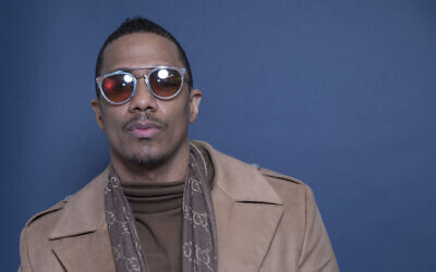 """In this Dec. 10, 2018 photo, Nick Cannon poses for a portrait in New York to promote promoting his new show, """"The Masked Singer."""" (Amy Sussman/Invision/AP)"""