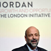 Jordanian Prime Minister Omar Razzaz speaks at the Jordan Growth and Opportunity Conference in London, February 28, 2019. (Toby Melville/PA via AP)