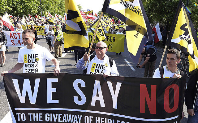 Thousands of Polish nationalists march to the US Embassy in Warsaw, Poland, on May 11, 2019, to protest US pressure on Poland to compensate Jews whose families lost property during the Holocaust. (AP Photo/Czarek Sokolowski)