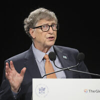 Bill Gates gestures as he speaks to the audience during the Global Fund to Fight AIDS event at the Lyon's congress hall, central France, Thursday, Oct. 10, 2019 (Ludovic Marin/Pool Photo via AP)