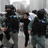 Policemen arrest a protester during a rally to show support for Uighurs and their fight for human rights in Hong Kong on December 22, 2019. (AP Photo/Lee Jin-man)