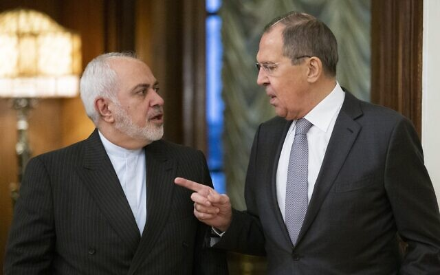 Russian Foreign Minister Sergey Lavrov, right, and Iranian Foreign Minister Mohammad Javad Zarif in Moscow, Russia, on December 30, 2019. (AP Photo/Alexander Zemlianichenko)