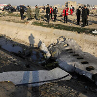 Debris is seen from the crashed Ukrainian as authorities work at the scene in Shahedshahr, southwest of Tehran, Iran, on January 8, 2020. (AP Photo/Ebrahim Noroozi)