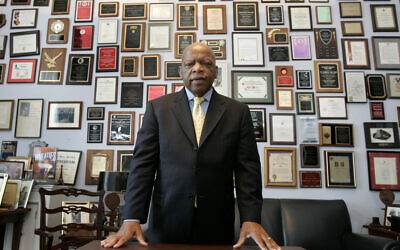 In this May 10, 2007 file photo, US Rep. John Lewis in his office on Capitol Hill, in Washington (AP Photo/Susan Walsh, File)