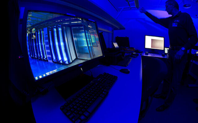 This Jan. 11, 2013 file photo of a staff member as he turns on the light in a lab at the Cybercrime Center at Europol headquarters in The Hague, Netherlands (AP Photo/Peter Dejong, File)