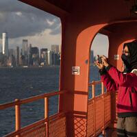Illustrative: Kahari Boyd rides the Staten Island Ferry, Tuesday, April 21, 2020, in New York. (AP Photo/Mark Lennihan)