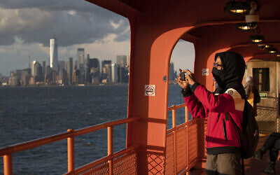 Illustrative: Kahari Boyd rides the Staten Island Ferry, Tuesday, April 21, 2020, in New York. (AP Photo/Mark Lennihan)