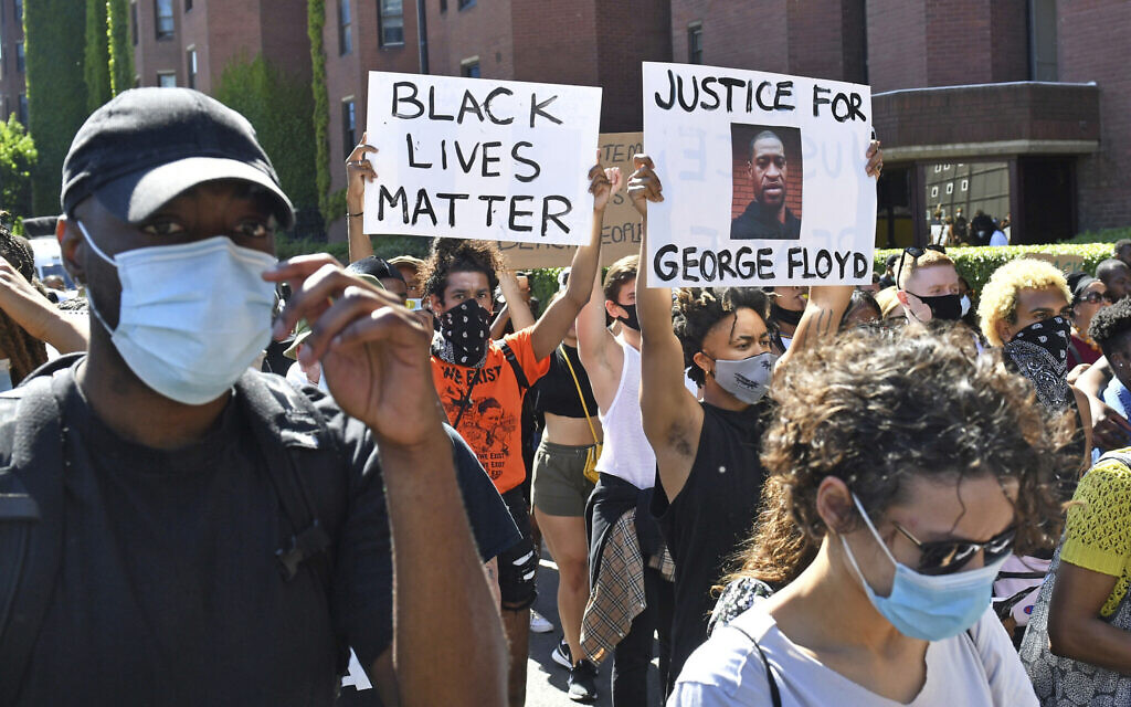 People take part in a Black Lives Matter protest outside the US Embassy in London Sunday, May 31, 2020, to protest against the recent killing of George Floyd by police officers in Minneapolis, Minnesota. (Dominic Lipinski/PA via AP)