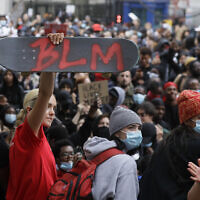 Illustrative: A protester holds up a skateboard with the Black Lives Matter initials in London, Wednesday, June 3, 2020, during a demonstration over the death of George Floyd, a black man who died after being restrained by police in Minneapolis, Minnesota. (AP Photo/Kirsty Wigglesworth)