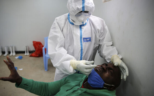 A Tanzanian truck driver reacts as he is tested for the coronavirus on the Kenya side of the Namanga border crossing with Tanzania, June 1, 2020. (Brian Inganga/AP)