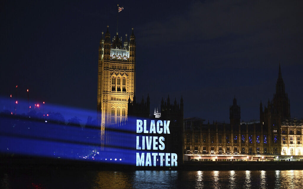 Black Lives Matter is projected onto the Houses of Parliament, in London, Friday, June 5, 2020, as part of the ongoing worldwide demonstrations following the death of George Floyd. (Victoria Jones/PA via AP)