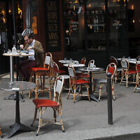 A man takes his lunch on a terrace at a restaurant, in Paris, June 15, 2020. (AP Photo/Francois Mori)
