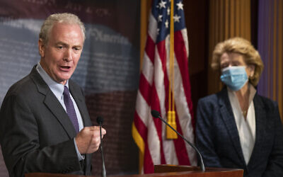 US Senator Chris Van Hollen, a Maryland Democrat, with Senator Debbie Stabenow, a Wisconsin Democrat, right, speaks during a news conference on Capitol Hill, June 16, 2020, in Washington. (AP Photo/Manuel Balce Ceneta)