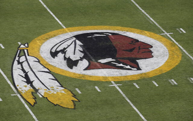 The Washington Redskins NFL football team logo is seen on the field before an NFL football preseason game against the New England Patriots in Landover, Maryland, August 7, 2014. (AP Photo/Alex Brandon, File)