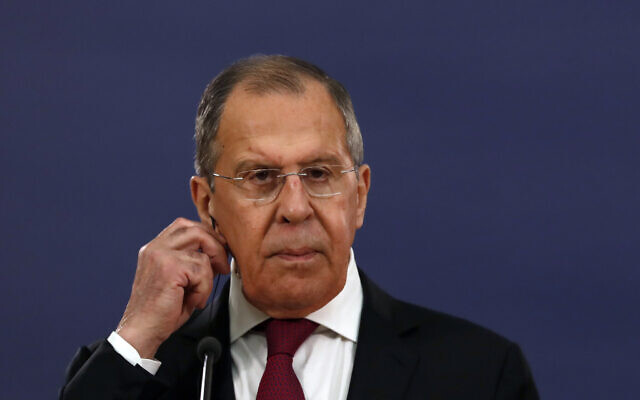 Russian Foreign Minister Sergey Lavrov listens as Serbia's President Aleksandar Vucic speaks during a joint press conference in Belgrade, Serbia, Thursday, June 18, 2020. (AP Photo/Darko Vojinovic)