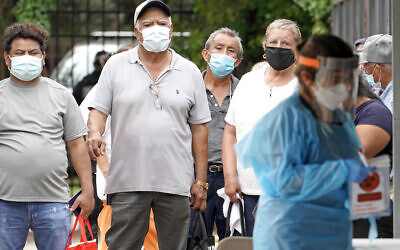 People wait in line at a free COVID-19 testing site provided by United Memorial Medical Center, at the Mexican Consulate on June 28, 2020, in Houston. (AP Photo/David J. Phillip)